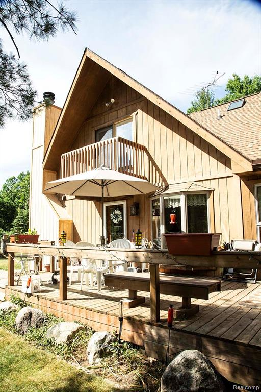 10 acres with Rifle River running thru it. Some features include:  first floor master bedroom w/ murphy bed, two additional bedrooms upstairs, new roof in 2015, 16k home generator, Two detached 24 X 24 garages. At the end of the 12 X36 deck is a 4-person hot tub spa. With a plethora of windows nature is abundant on this wooded land.