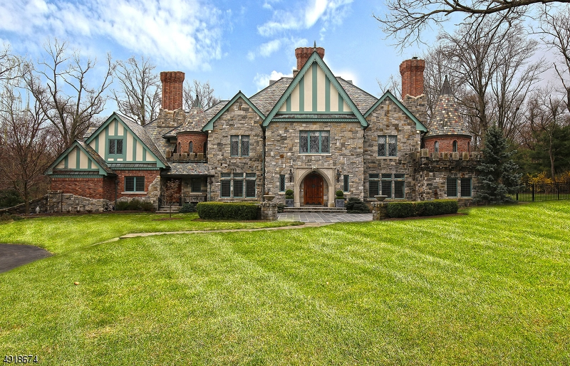 This exquisitely designed custom home rests on 5.4 acres of gorgeous property. Exceptional lifestyle awaits with architectural details abound and highest quality finishes. Only 25 miles from NYC! Highlights: private gate, sweeping front lawns, beautiful brick masonry, foyer w/ butterfly staircase, broad archways, generous rooms, HW floors, 3 fireplaces, gourmet kitchen open to huge family room, library w/ custom Mahogany shelves, wine tasting room w/ 20' peaked ceiling, private home gym w/ steam & sauna, California walk-in closets, master bath, lower level w/ rec room, game room, media room & storage, bluestone patio overlooking expansive backyard w/ in-ground pool, oversized 4-car garage, private dog run, brand new security system.Train service to NYC's Penn Station is 44 mins from neighboring Summit.