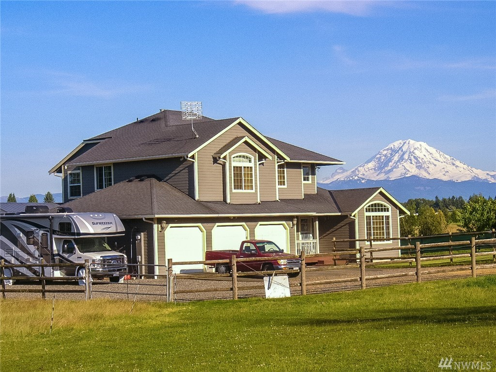 Custom built Home with spectacular Unobstructed views of Mt Rainier. Flat pasture 5 acres with room for horses. Property includes horse stalls, two sheds, RV Parking, and a 3 car garage. 4 roomy bedrooms with 2.5 bathrooms +Den/Office. Master Bedroom has a walk-in closet and a 5-piece bath. Large kitchen with island and stainless steel appliances. Living, dining, and family rooms with views of Mt Rainier from your couch.  Private secluded property just minutes from DT Auburn, 18, 167, I-5.