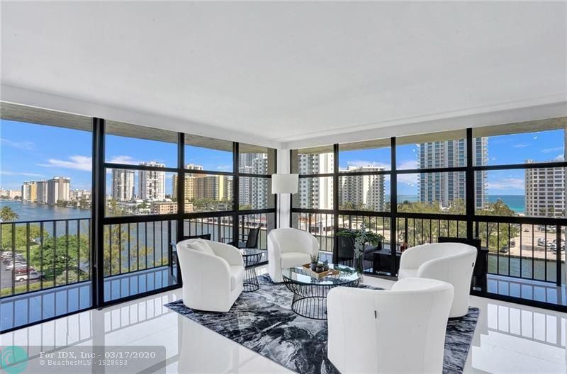 """ABSOLUTELY GORGEOUS, JUST SIT ON YOUR WRAP AROUND BALCONY AND ENJOY THIS VIEW OF THE OCEAN AND THE INTRACOASTAL. THIS UNIT HAS BEEN TOTALLY REDONE WITH TASTE AND IT'S BEING SOLD ALL FURNISHED TURN KEY. 32"""" TILE THROUGHOUT. OPEN KITCHEN  WITH GRANITE COUNTERTOP AND TOP OF THE LINE BLACK STAINLESS STEEL APPLIANCES. CENTRAL VACUUM, NEW WASHER AND DRYER VENT LESS IN UNIT. ELECTRIC FIREPLACE IN BEDROOM. NEWER A/C(2019) AND WATER HEATER (2019). COVERED PARKING. THIS IS A MUST SEE.  THE UNIT IS VACANT AND CAN EASILY BE SHOWN."""