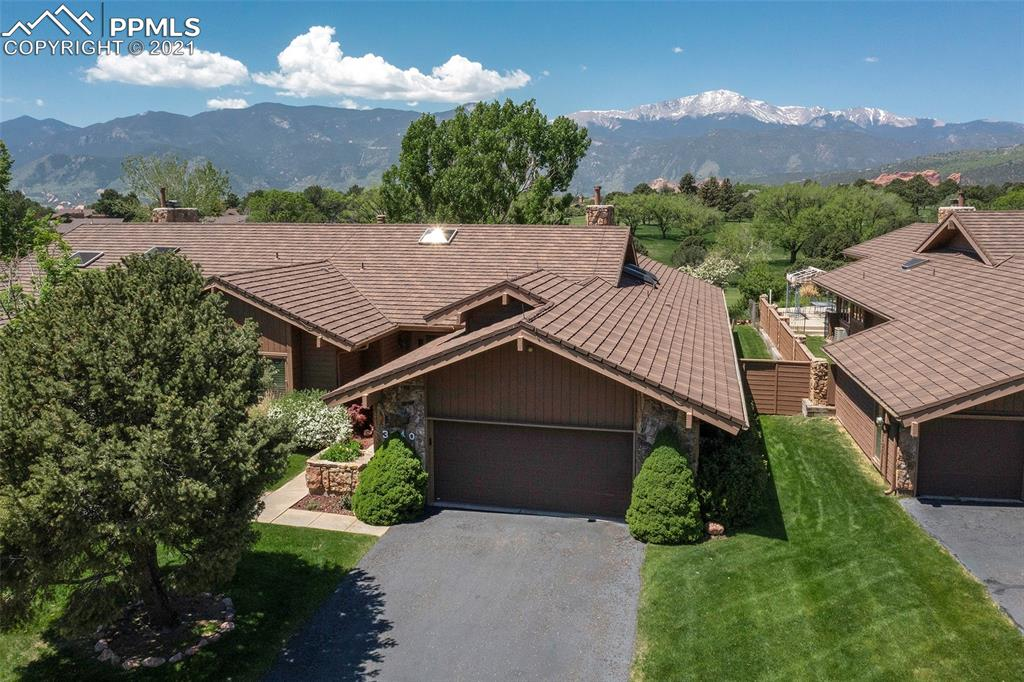 Enjoy the Amazing Views and Option for Main-Level Living!  This terrific golf course townhome features 5 bedrooms, 4 baths, 2-car oversized garage and magnificent views of Pikes Peak. The main level includes the great room with wet bar and separate dining room both with walkouts to the covered patio, kitchen with an abundance of cabinet space,  island with cooktop, pantry and breakfast area with walkout to a covered patio.  The bedrooms located on the main level include the master suite with 5-piece bath and walkout, second bedroom with bench seat and the third bedroom which would also make a great office.  The basement features a spacious recreation room, two bedrooms both with walk-in closets, wet bar and two large bonus rooms. The outdoor spaces include an wonderful west facing patio that runs the length of the home, fenced backyard and uninterrupted golf course, Front Range and Pikes Peak views.