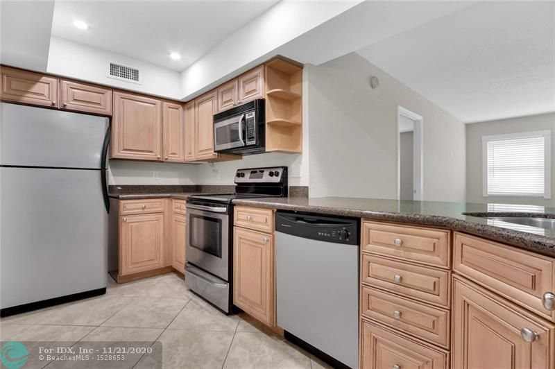 Beautifully renovated ground-level 2BR/2BA in Victoria Park boutique condominium. Live steps from Holiday Park and tennis center and just minutes from Downtown and Fort Lauderdale Beach. Spacious and sunlit 1020 sq ft unit with open concept floor plan. Kitchen features granite counters, stainless appliances, recessed lighting, and counter seating. Redesigned bath with granite, frameless shower. Hurricane impact windows. Diagonal beige tile in living, dining and kitchen.  Secure entry building with interior hallways, heated, pool, BBQ, large clean laundry facility, storage, ample guest parking.  No pets per building. Walking distance to new dining, supermarkets, and shops.