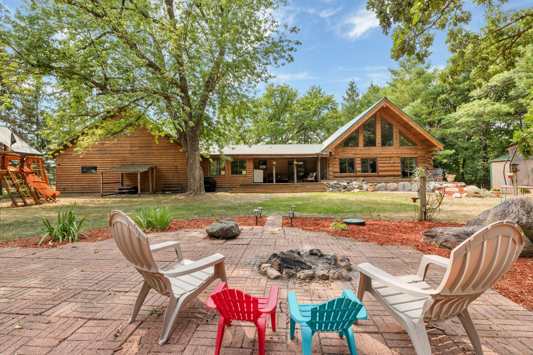 If location is everything, this is the place for you! This 4 bed, 3 bath log home sits on a tar road very near to Lake Koronis' paved walking/bike trail and just a short distance from the lake and golf course. Features and updates by the current owners abound at this property! The kitchen boasts granite counters, hickory cabinets, ss appliances, and oak floors. 3 bedrooms, 2 bathrooms, the great room, dining room, and mudroom are also found on the main floor. The great room has beautiful log accents, a wood burning fireplace, a loft overlooking it, and huge windows with gorgeous views of nature! The basement has a large family room, 4th bedroom, and additional bathroom. Attached to the home is a heated and insulated 3-stall garage with an insulated bonus room above that is ready to be finished. Insulated 30' by 18' pole shed and smaller 8' by 8' allow room for toys or a shop. You will feel like you are up north when you step into the back yard! Out of room! Come look for more!