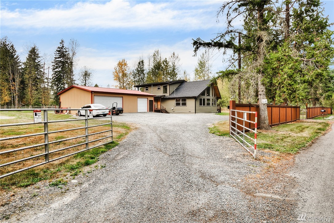 Stunning custom built home on 10 acre Equestrian property!  Equestrian amenities incl. 1,200 sq ft barn ft. 2 standing stalls w/turn outs, tack rm, Corliss arena mix/grass & 130x100 outdoor arena. 3 car garage w/shop space. 2331 SF, 3 beds/1.75 bath with open plan and vaulted ceilings. Laminate hardwood floors, beautiful wood beams/trim & doors & counter tops. Iron rail staircase, loft and tons of natural light! Master suite w/custom WI shower & balcony. One of a kind gated, secluded property.