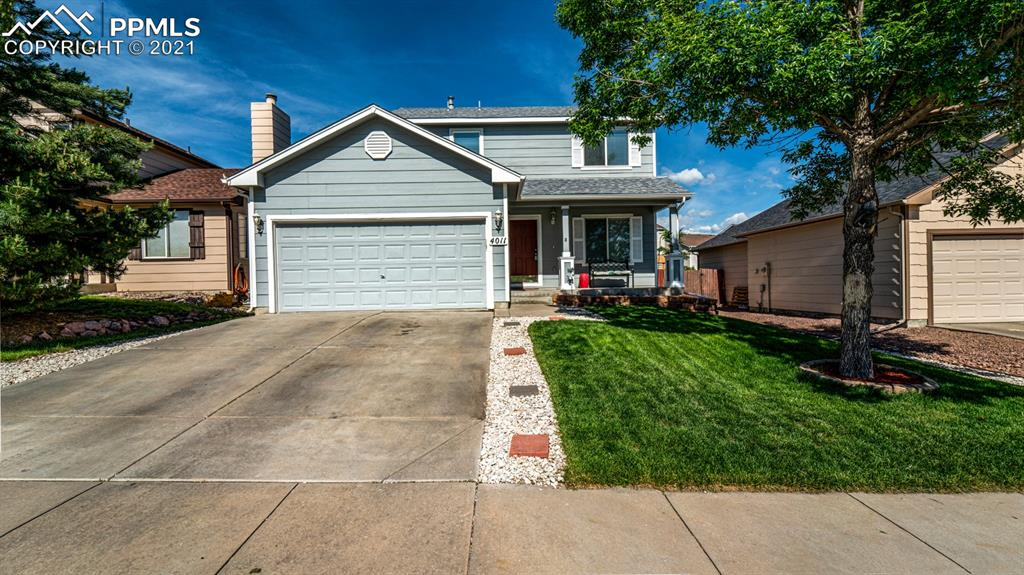 BEAUTIFUL TWO-STORY WITH COVERED PORCH. KITCHEN WITH GRANITE COUNTERTOPS. FORMAL LIVING ROOM. MASTER BEDROOM WITH SEPARATE FULL BATH. FULL BASEMENT WITH FAMILY/REC ROOM. LARGE BACKYARD WITH 20X10 DECK!