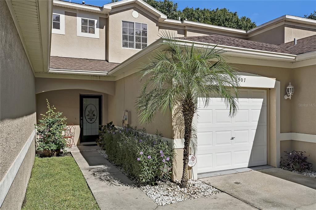 Take a look at this beautiful townhouse tucked away in the lovely Casa Blanca Community, located near Westchase and Citrus Park! Built in 2001, this home comes with 2 beds, 2.5 baths and one car garage as well as dedicated guest parking. Upon entering the home you'll notice a nice open kitchen with tiled floors and solid oak cabinets, as well as a cozy living room perfect for entertaining guests! The master bedroom has laminate floors, a walk in closet and a remodeled master bathroom! The rear sliding doors make way to an open deck that backs up to relaxing green scenery, perfect for a small garden. This home even comes with a water softener! Casa Blanca is stunning with it's well maintained landscaping that surrounds the neighborhood and even has a small nature trail that leads to the secluded community pool! Monthly HoA fees of $300.00 per month covers the water, roof, exterior insurance, lawn care, and the pool. This property is located in a very convenient part of Tampa. The Veterans high way leaves you fifteen minutes from Tampa International Airport, 25 minutes to both Downtown Tampa and Downtown St. Petersburg, and just 30 minutes to hit the beaches! There are many different restaurants and supermarkets close by, as well as the Citrus Park Mall and the Upper Tampa Bay Trail. Come see this home for yourself before it's too late!