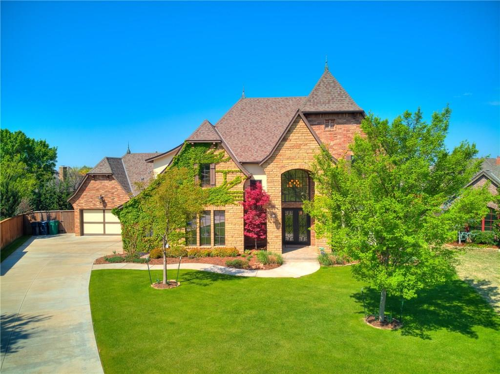 What a gem in a premier, gated golf course community! French glass, iron doors open to a 25 ft entry and open-concept kitchen/living. No detail was left behind with rich wood and iron. .. Solid wood doors, surround sound, plantation shuttersthroughout, arch door ways throughout. Hand scraped wood floors in living and kitchen. Luxurious master suite with private bath, walk in shower and large closet! 4 bed or 3+ study. Tons of storage and a storm shelter! Oversized backyard.