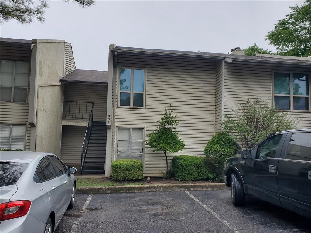 Rare 3-bedroom in gated Cardinal Creek HOA. Two exterior balconies, spacious rooms, fireplace, granite counters, washer and dryer, pantry, walk-in closets, and much more. Backyard overlooks OU golf course. Monthly dues include water, insurance, landscaping, trash, exterior maintenance. Close to everything and OU. There is a sign-up fee equal to three months' dues at closing. This truly is one of the rare, extremely large, condos in Norman. First home, great for multiple students, investment.