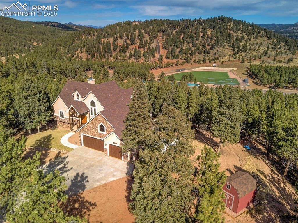 Seclusion is at the Heart of this Luxury Mountain Home on 1.16 Acres! Tranquil Wooded Setting w/No Covenants & Multi Generational Living or Air BNB Options. Spacious Main Level Living is Perfect for Entertaining. GREAT ROOM-Covered Entry w/Custom Wildlife Metal Railings & Etched Tile* Soaring Prow Wall of Windows highlighting Expansive Forest & Mountain Views*Dramatic Vaulted Beamed Ceiling*2 story Stone Fireplace*Wood Floors*Opens to huge deck w/2 covered areas*Quite Impressive! KITCHEN-Well appointed w/Alder Cabinets, Granite Counters, Stainless Appliances, Double Ovens, Large Pantry, Elevated Dishwasher*MASTER SUITE-Amply sized w/2 Walk In Closets*Heated & Jetted Tub*Rain & Double Shower Heads*2 separate elevated Granite Sinks & Linen Closets*UPPER LEVEL-Loft Desk Area w/Full Mountain View*2 massive bedrooms w/Vaulted Ceilings, Views & 2 Storage/Play Areas*Full Bath w/separate water closet & lots of natural light. LOWER LEVEL-2nd Master Suite w/Double Fireplace, 5 Piece Bath w/Heated & Jetted Tub, Double Vanities & Walk In Closet*Original Building Plans for addt'l 2 Bedrooms, Family Rm w/Fireplace (piped in), 5th Bath and 2nd Laundry (plumbed in)*Current hallway wall isn't a support wall & can be removed*Walk out to Covered Deck*Great Rental Option*Ultra Efficient 7 Zone Tankless Hot Water Radiant Heat*LOW LOW Energy Bills*Central Vacuum*GARAGE –Mechanics Dream*Heated, insulated & dry-walled*220V outlets & 6 Air Chucks installed*Enclosed storage*Hot & Cold Water Connections & Utility Sink*Bose Speaker System*Work Bench*LED Shop Lights & 2 Auto Motion Interior Lights*Vaulted Ceiling & lots of Natural Light*Even w/Main Level*Entry to Mud Room. LOT FEATURES-Bordered by large west parcel & no build areas to the north*Split Rail no climb wire fenced for pets*Dog door to the Heated Garage*Storage Shed*Complete RV Water, Electric & Sewer Hook Up*Tons of Parking for all your Toys/Trailers/Work Vehicles*Meadow Wood Sports Complex around the block*This is a Fantastic Home!
