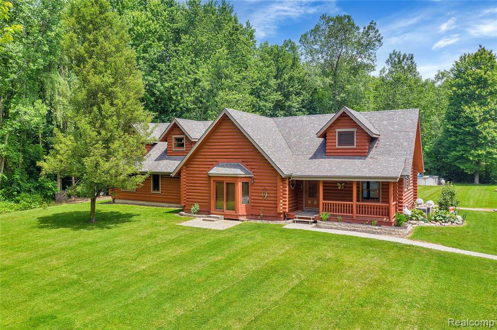This beautiful custom log home set on 5.13 private acres. Ten inch Northern Red Pine Logs milled in Munising, MI. Exterior logs recently stained. Close to the St. Clair River, Lake St. Clair, and Harsens Island. The exterior features a three car garage with an attached dog kennel, an above ground pool, and a large pond. Open concept home with six bedrooms; three bedrooms on the main floor and three on the second floor. First floor master suite with en suite bathroom and walk in closet. This home also features a second floor master bedroom with en suite bathroom. Gorgeous knotty pine vaulted ceilings. The spacious great room overlooks the property, pond and wildlife. A large Michigan basement with concrete floor makes for perfect storage. Large exposed aggregate patio with built in fire pit. This home also has two furnaces, two A/C units and beautiful landscaping. City water and septic. Country living with the amenities of the city.