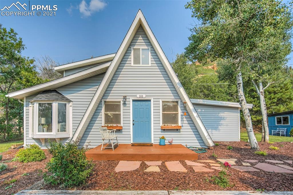 Watch the paddle boarders on Palmer Lake from the front porch of this completely updated A frame. Walk to town,  Or catch a local hiking trail! Almost a 1/2 acre lots. This house is so completely adorable! Move in ready and just waiting for you!
