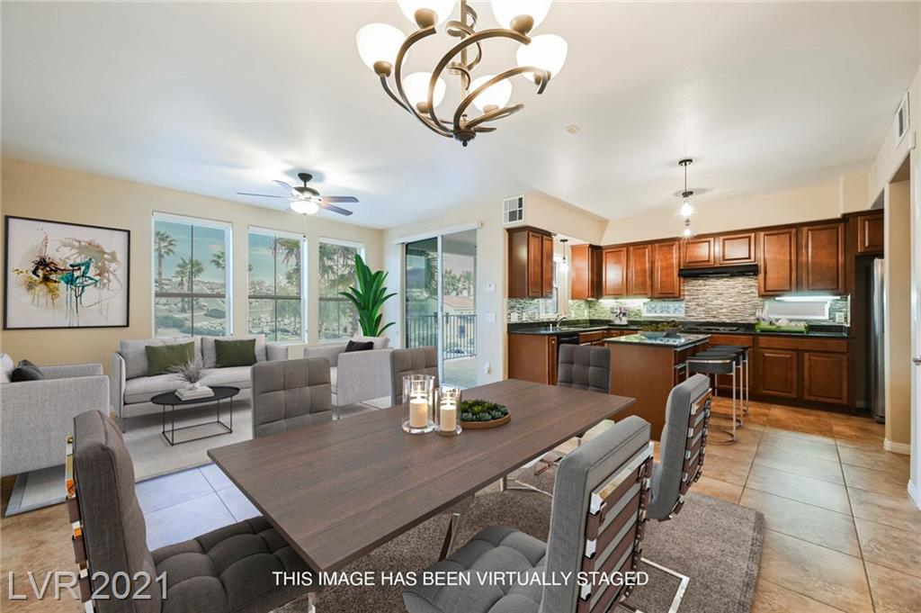 Beautifully maintained and like new condo in the sought after Terra Bella Condo's in Anthem. Gated neighborhood,beautifulclubhouse,communitypool,communityspa,exerciseroom,andaRecreation room. Sewer, water, and trash included with the HOA. Beautful flooring through out, and beautiful kitchen with granite counter tops, modern backsplash. Balcony with views of beautiful community clubhouse, pool, and LARGE water feature. Extremely spacious and smart floorpan. All appliances to convey. This home is ready for you to enjoy. FAST MOVE IN!!!