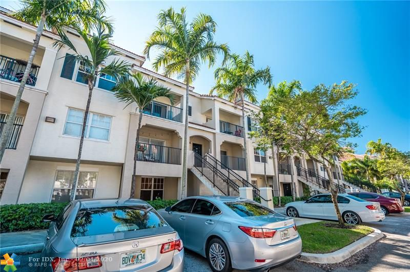 GREAT 3RD FLOOR UNIT WITH DETACHED GARAGE ACROSS FROM FRONT DOOR, IN THE RESORT STYLE POINCIANA PLACE. WALKING DISTANCE TO MAJOR RETAILERS, SHOPS, AND RESTAURANTS. LUXURY COMMUNITY CLUB HOUSE, COMMUNITY POOL, STATE OF THE ART EXERCISE ROOM, POOL TABLE, AND BBQ AREA. WATER AND BASIC CABLE INCLUDED.