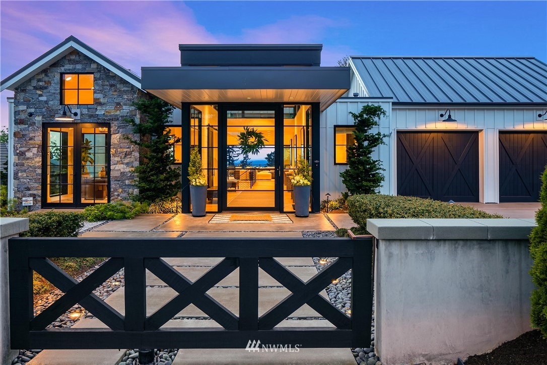 Straight out of Architectural Digest, this custom luxury home takes modern farmhouse to stunning new heights. Harrison neighborhood is the pinnacle of Issaquah, revered for its panoramic views and timeless architecture. Step through the glass, pivot door into the grand entry which showcases magnificent windows, wide planked European oak floors & shiplap walls. Flooded with light the main level living area features a 525 bottle, temperature controlled wine wall, stacking slider doors, heated outdoor living spaces with views of lakes, cityscapes & mountains. Kitchen features double islands, & luxury appliance package. No expense has been spared in the thoughtful design, high quality materials & brilliantly styled by Restoration Hardware.