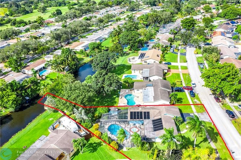 """This awesome 4/2 pool & water view home on a huge & unique 1/3 acre lot is a rare find in Cooper City's Timberlake community. As you enter the home you are presented with a huge open floor plan over recently installed 18"""" diagonal tile. Updated Kitchen & formal Dining Room to the left, large living & family room ahead & 4 bedrooms to the right. From the wide kitchen window to the rear of the home reveals a large covered patio, & then a huge screened in solar-heated pool area with separate spa. Through the back screen door is a pathway through lush landscaping (check out the Staghorn Fern!) to a private dock on a tranquil natural bank canal! Huge wooden shed for storage & workshop. Your home is your castle with a 25KW whole-home propane generator 2016. See pic descriptions for more detail."""