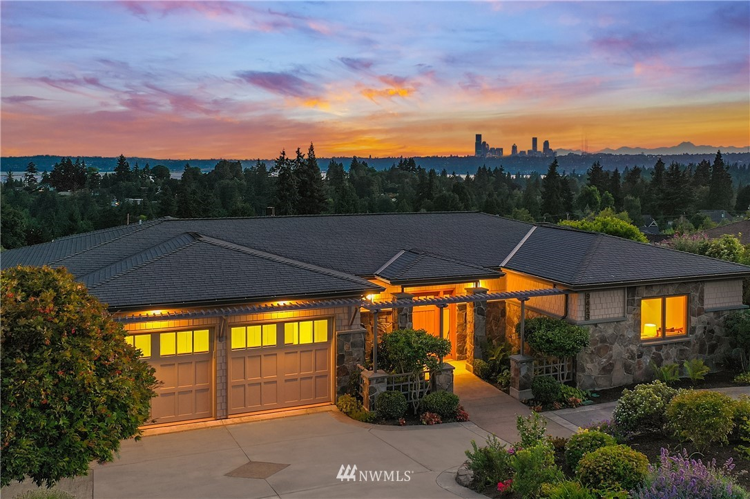 Central Bellevue Location w spectacular Seattle Skyline, Lake WA & Majestic Olympic Mtn Views! Nestled in the coveted Vuecrest neighborhood, luxury interiors open to Pacific NW Views. Today's active lifestyles are effortless w office/remote learning spaces, dedicated media room & seamless indoor/outdoor recreation areas. Main Level Primary & Guest Suites create a forever home! Enriched by lavish upgrades of vertical grain fir cabinetry & doors, auto privacy shades, Lutron lighting & integrated surround sound systems, this Custom Talbott Home extends to glorious gardens that create an oasis of reflection and relaxation. Sparkling Seattle City Lights greet from your View Terrace, just moments from the vibrant city life in DT Bellevue!