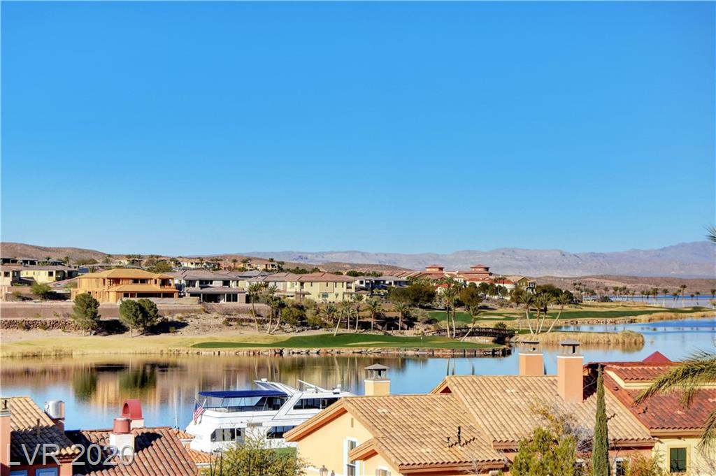 Panoramic views of the Lake! Lovely 2 bedroom furnished unit. Nicely remodeled including new flooring and furnishings. Unit also has washer/dryer. HOA dues include all utilities, internet, cable, underground parking and use of the 2 community pools, spa and fitness room. Stroll to the Village and dine at the restaurants or shop at the Grocery store. Enjoy all the water sports or rent an electric boat. Lake Las Vegas Resort living is the best!