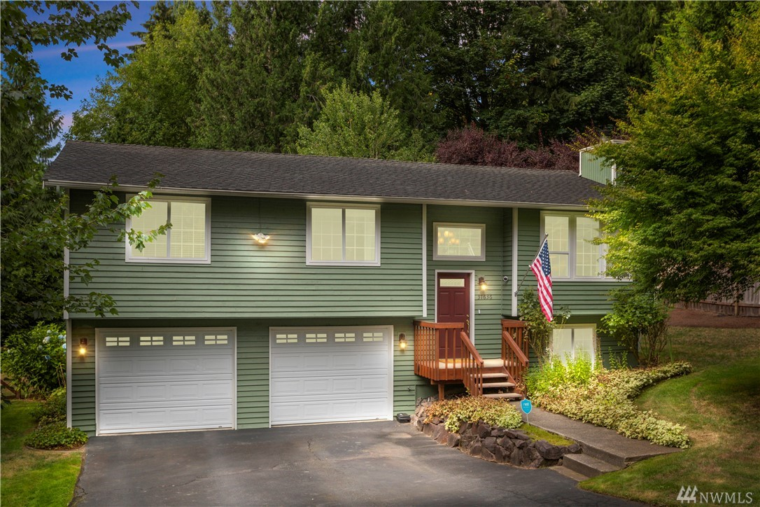 Charming 3 bed / 2.5 bath home on level 1/3 acre lot in coveted Lake Marcel. Enjoy an open layout & several tasteful upgrades: granite counters, SS appliances, gas range, modern white cabinets, glass pendants, gleaming hardwood floors, cozy fireplace, remodeled main bath & more. Finished basement with 3/4 bath offers great flex space for home office, guest room, home gym, movie room - you name it! Large deck off dining room for entertaining & access to huge fenced yard w/shed. Walk to Beach 1!