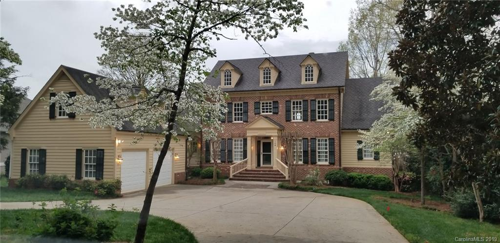 7 bedroom, 6.5 bath luxurious home, nestled in one of best locations on Lake Norman. Gorgeous on the Lake home with stunning panoramic sunset views year round is located only 20 miles from Charlotte and 1 mile to I77.  One-of-a-kind custom built home offers generous space with genuine hardwood floors throughout house, crafted from wood that came from the Sears Tower! Spacious Master bedroom and bath on main level with access to huge rear deck which leads down to your pier, gazebo and 2 boat slips, one featuring a lift. 2 fireplaces one on main level and one in lower level with bar/recreation and family rooms which opens out onto the covered brick patio, a fantastic area for entertaining.  Large bedroom suite located on this level also opens to the covered patio.  Detached 2 car garage is connected to the main house with a covered breezeway and includes a 2nd living quarters above. This elegant all brick home with custom designed wood shutters has so much character.  See Features List