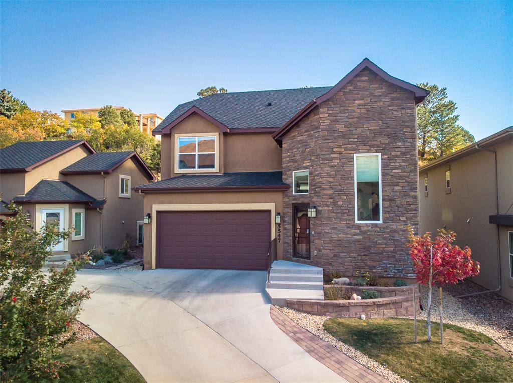 Location, location, location! This gorgeous home sits in the highly desired neighborhood of Mountain Shadows, just south of the Air Force Academy. Welcome to Westside living! The home has the most incredible views which can be enjoyed from inside your home or while you're taking a walk around the neighborhood. There are tons of parks and trails nearby, and it is a five minute drive from Chipeta Elementary School, as well as five minute drive to Garden of the Gods and Ute Valley Park!  As you walk into this very elegantly designed home, the first thing you notice is the beautiful hardwood flooring throughout the main floor. The kitchen has been newly remodeled, with fresh paint and high-end granite throughout. The kitchen also boasts a gas stove and newer appliances. The main floor consists of a large mud room as well as a powder room, kitchen, dining room and family room. The top floor consist of the primary bedroom with an en suite bathroom, as well as two bedrooms and a shared bathroom. The basement is fully finished, and has a large entertaining space perfect for a theater room. The basement also has a full bathroom as well as an additional bedroom, which could also be used as an office. The home features brand new carpet and window coverings for a move-in ready experience!