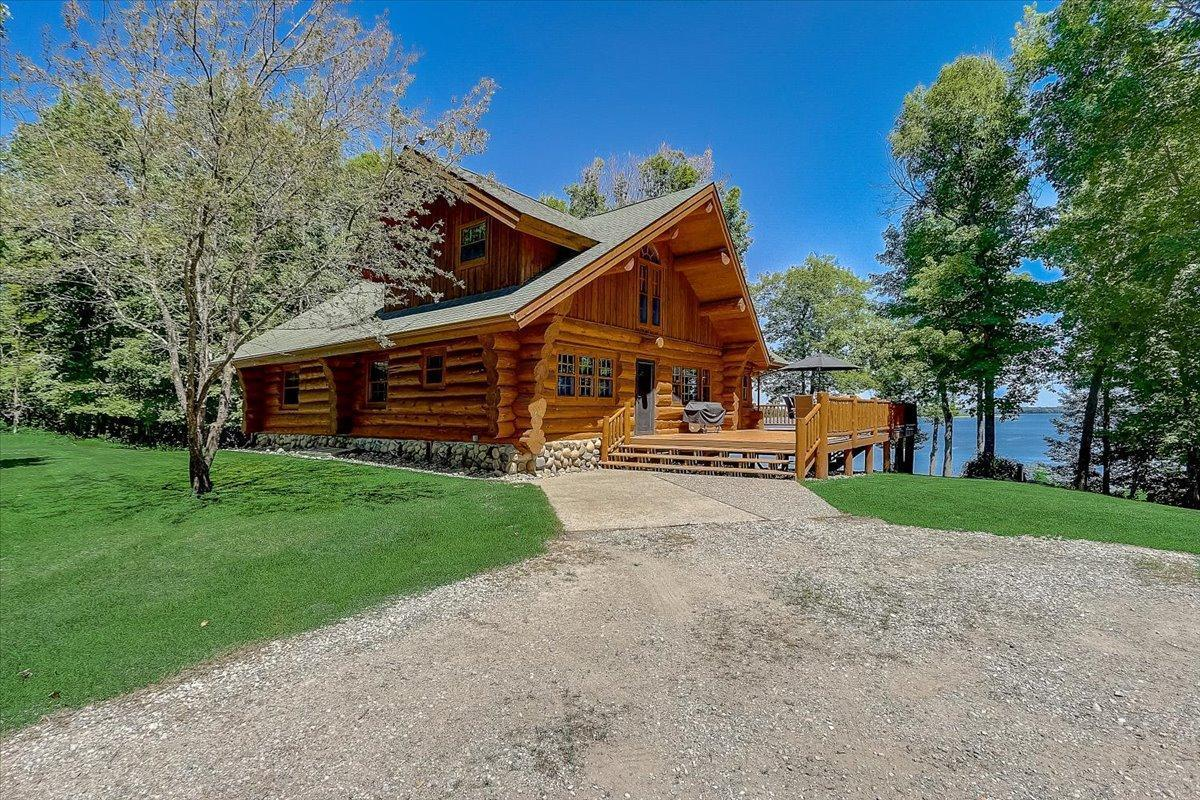 This home looks & feels like a resort getaway! A stunning full log home on the south side of Leech Lake, located on a 1.72-acre lot in between Chippewa National Forest land for a true private experience. 150-ft of Leech Lake Shore and a great fishing bay all to yourself! Solid hardwood floors throughout main and upper level! Gourmet Kitchen with new SS appliances. Amazing Living Room with 19ft vaulted ceilings, real stone wood-burning fireplace & easy access to the wrap-around deck providing breathtaking views. 4 bedrooms including a private Master Suite. Plenty of sleeping room for guests located in the upper lever loft! New instant water heater installed this year. All other utilities replaced in the past 3 years. Dock and Boat lift are included with the home! A total MUST SEE!