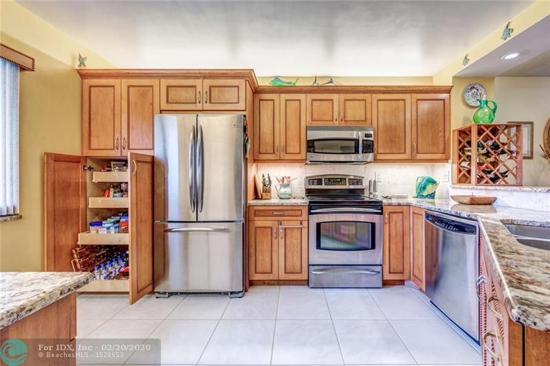"""Over $35,000 in upgrades!! This gorgeous 1st floor unit boasts a beautiful lake view on """"The Island"""". New stranded bamboo flooring in 2018, Gourmet kitchen w/1.25"""" granite counter top, Custom Built Maple Wood cabinets w/under cabinet lighting & pull out drawers, Premium S/S appliances; frame less shower doors & custom cabinets in bathrooms; HI efficiency w/d in your own laundry rm; a Honda GENERATOR; shutters for patio slider & Hurricane rated windows. Cypress Bend has resort amenities, is PET friendly, & has a low maintenance fee.  Park in front of your unit! Association requires 10% down payment on contract & minimum 670 credit score. Buyer to use Seller's closing agent and Seller to pay for Buyers title policy. Irresistible price for a condo that's like living in your own home."""
