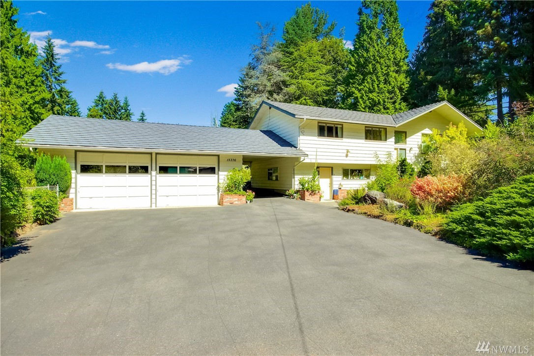 """Located in the Northshore School District, this split level home on a beautiful tree lined street sits on .48 acres. Fully landscaped, mature trees + park-like back yard complete w/a pond. Main floor has 3 bedrooms, 1 3/4 baths, spacious living room w/fpl, dining area & kitchen. Lower level with separate entrance could be MIL or ?? Large living area w/fpl, laundry w/sink + 3 additional rooms. LOADS OF POTENTIAL! Over-sized detached 2 car garage+covered carport.Property sold in """"as is"""" condition."""