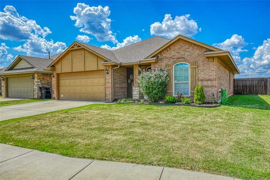 Cozy three bedroom home with open Living Room and Kitchen. Lovely floor plan that includes hardwood flooring, trendy paint colors, covered back patio and a rounded hallway arch that sets the tone of this beautiful brick home.