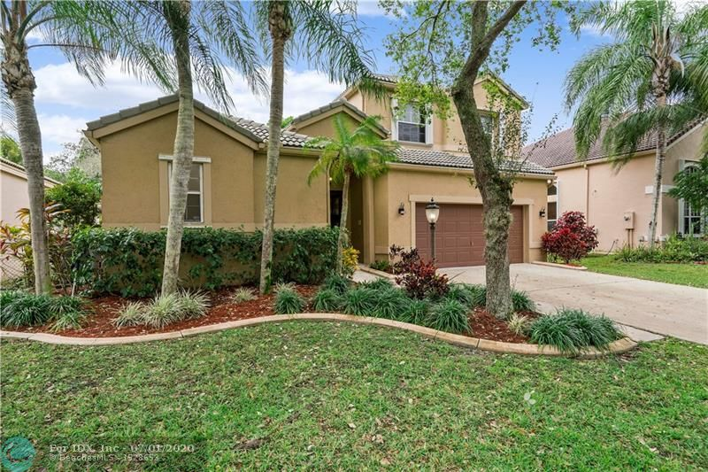 Beautiful courtyard style home in the heart of Parkland,with easy access to Sawgrass Expressway and major highways. Excellent schools in a quiet gated community with 24 hour guard gate. House features an updated kitchen, stainless steel appliances, soft close drawers, newer new AC, newer water heater. Open concept in the main house features 3 bedrooms, office, 2.5 baths, formal living and dining rooms, very bright family room, 24x24 travertine stone tile throughout. Spacious master suite with high end upgrades, roman tub, open rainfall shower and vessel sinks. Community has a beautiful lake, pool, clubhouse and small gym.