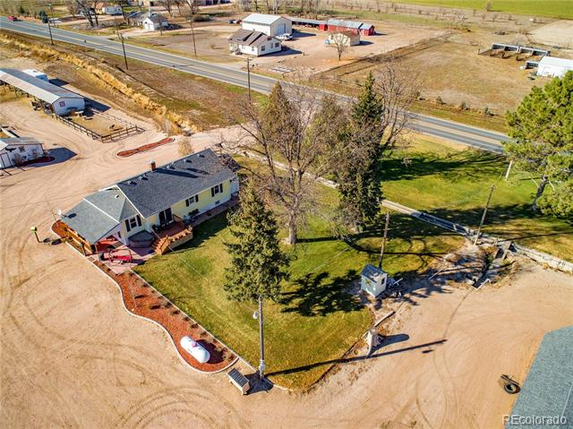 Welcome to country living & Kersey schools! Wanting to get away from the city? Cozy & spacious ranch style home with 4 bedrooms, 2 bathrooms & a 3 car detached garage. Sliding doors go out from master bedroom to a side deck, also 2 additional covered patios. Sits on a great piece of property with 2.49 acres. Bring all your toys and animals. Features a 33x25 barn, 25x22 chicken coop, 20x12 peacock shed, 115x20 lean-to & fruit orchard. Newer roof, siding A/C, furnace & bay windows. A must see!