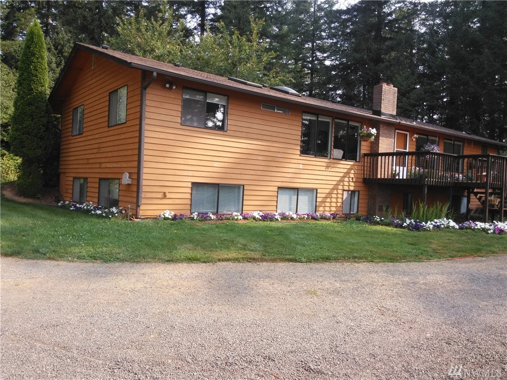 7+ Secluded & private acres with amazing Mount St. Helens & territorial views. This well maintained 3 bed, 3 full bath home has a fully finished daylight basement with attached garage.  A great main floor living area, kitchen with island & formal dining rm. The lower level includes 2 large open rooms, a full bath along with a storage room. This home is embraced by mature timbers, sweeping views, shop, RV parking and fenced garden area. Close to Cowlitz fishing, & Mayfield & Riffe Lakes.