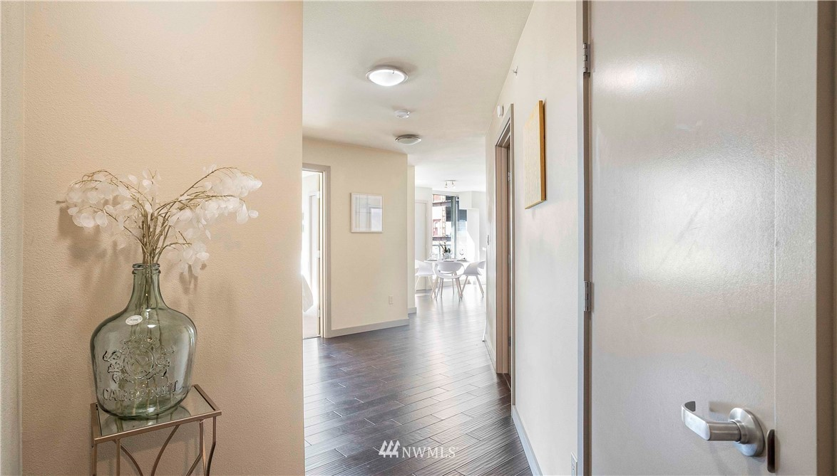 Prime Location! This 2 Bedroom 1.75 Bathroom is just minutes away from local shops, restaurants, parks, and entertainment.  Secure garage w/ 2 pkg spaces.  This SE corner unit w/open floor plan has generous, flexible living & dining areas.  Master suite w/walk-in closet & Bath. 2nd bdrm + full bath. The complex features a concierge, owners lounge, fitness room, business center, and guest suite. The building is concrete and steel. Across to Amazon's new building. NO RENT CAP