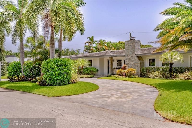 This spectacular 3 bedroom, 3 1/2 bath home has 3000 sq.ft. of living area to spread out. The Living Rm w/fireplace-Dining Room-open Kitchen Main area is the heart of the home, all overlooking the HUGE pool & patio. 3 Bedrooms & 2 Full Baths are on one side, + a 20'x24' Family Rm/TV lounge/Party room w/full Kitchen + 3rd bath (think 2nd Master Suite?) also facing the pool on the other. The spacious Master Suite has a 17' walk-in closet and a luxuriously large Master Bath w/6' spa tub. Fully walled VERY PRIVATE LUSH back yard w/32' heated pool, waterfall fountain & pool bar, & a completely separate 1/2 bath JUST for pool area. 3 yr. old concrete roof, silver finish impact windows & doors, plumbing, wiring, circular paver drive, floors, baths & kitchen. 2 Car Garage, 2 storage rooms & MORE !