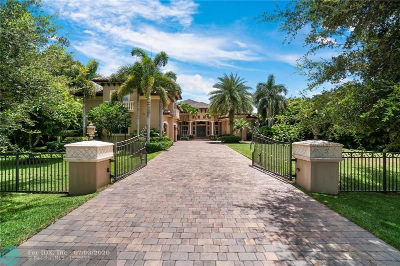 Grand in scale and opulent in style, this stunning custom-built fully fenced gated estate in the heart of Plantation Acres is the epitome of luxurious living. The layout offers six bedrooms, seven bathrooms, an office and a loft. The master suite overlooks the pool and offers a morning coffee bar, two walk-in closets with custom built-ins, a separate shoes & bags closet plus a luxurious master bath with twin vanities, dual showers and a free-standing tub. The gourmet kitchen with a gas cooktop, a convection double oven, two separate sinks and a large island is ready for the home chef. Perfect for entertaining, this home features a summer kitchen, a custom pool with waterfall, a jacuzzi that holds 10+ people, an expansive multi-level travertine patio and an oversized backyard.