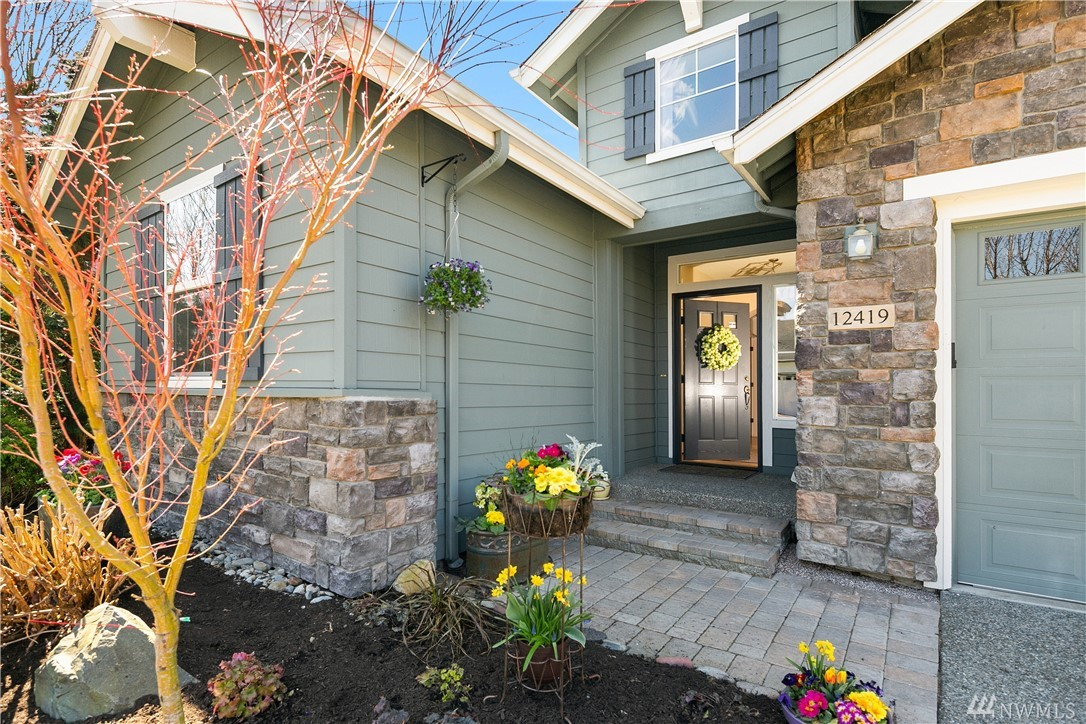 """The ever popular """"Bainbridge"""" plan. Coveted for its terrific layout. $70,000 in upgrades since 2015.Great room boasts chef's kitchen w/large eating-island & black stainless steel apps. You'll love the spa master suite.Den/Office. Beautifully landscaped rear & extra-large side yard is a relaxing oasis, water feature w/Gold fish. Home is just blocks to the Trilogy Club House, the hub of all activities and ideal for your frequent visits & mail pick up. Trails, golf course.Air cond.55+ community."""