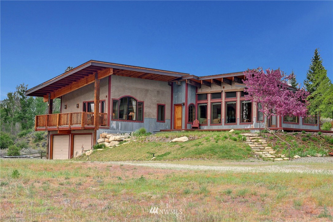 "Contemporary home sits above an amazing stretch of private low bank riverfront. Custom home w/great details: 100 yr. old recycled beams, copper Mexican sink & tiles, wine cellar. Master suite w/private deck, soaking tub & shower. Total 3 bedrooms. Hall bath w/walk-in shower. Laundry rm. Two living areas separated by gas double sided fireplace w/vintage marble hearth. Open kitchen/dining. Sun room. Low maintenance landscaping. Picnic at the ""River Hut."" Also 1 bed guest cottage & shop building."