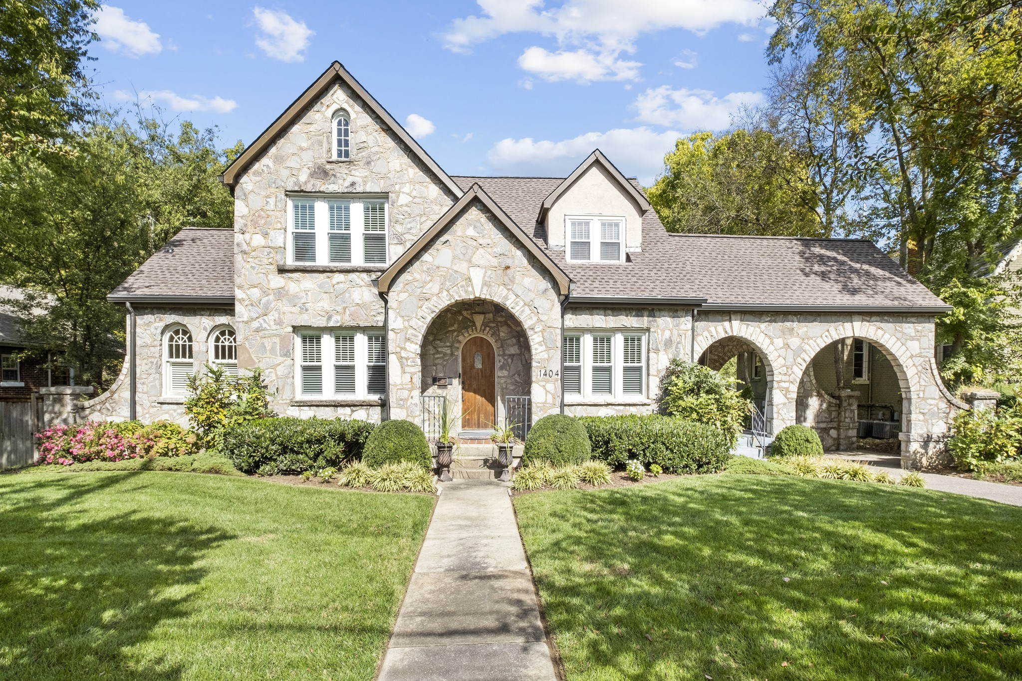 Totally renovated and expanded picture-perfect stone Tudor home with FABULOUS new pool, stone fireplace, grill & guest house. Main or Upper Level Master Options. Open living room w/large multi-use sunroom. Upscale kitchen and den overlooking covered wraparound porch deck & pool. Charming stone side dining porch. RARE double lot with terrific side and backyard.  Walk to Music Row, VUMC, the Roundabout restaurant and the Gulch. Great mud room entrance. New roof in 2020. Newer HVAC system,