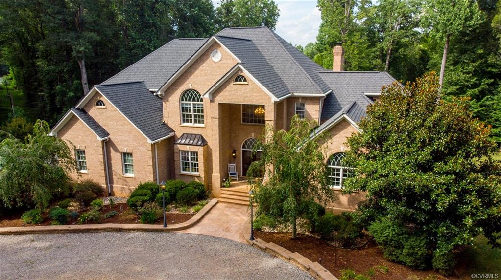 Come see this custom home on 3 private acres in Powhatan minutes away from 288! On your lot you'll find an all brick detached shed, 3 car garage w/keyless entry, invisible fence around perimeter, irrigation in the landscape beds and huge deck & screened in porch. As you enter the home, be wowed by a grand foyer which consists of granite flooring and a custom built stairway. Off the foyer is a huge formal dining room with Bolivia Rosewood floors. Continue to the luxurious custom Kitchen w/ all Wolf appliances, custom cabinets, double sized Sub zero fridge, gas stovetop, and huge island. Kitchen opens up into the living room with 20 ft vaulted ceilings, gas fireplace, and large windows.   Finish out the 1st floor with a spacious master bedroom including a master bathroom w/ heated floors, deep jetted tub, his/her sinks, walk in closets and surround sound system throughout.  On the second story you'll find three more generously sized bedrooms, and a hardwood loft area. The finished basement is covered in laminate flooring including a 32 X 19 bonus room w/ wood burning fireplace perfect for with direct access to the picturesque lawn. Make an offer on your private paradise today.