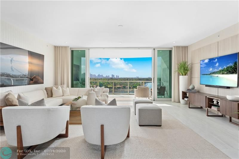 This is a model residence that is fully furnished and designed by Interiors by Steven G. Experience breathtaking panoramic views of the intracoastal waterway, Atlantic ocean & Downtown Fort Lauderdale skyline. Ideally situated on the East side on the intracoastal on the barrier island. 321 at Water's Edge 23 condominium estates feature breathtaking views, high end designer finishes, expansive flow through floor plans and outdoor living spaces. Valet/ concierge 24/7 & 2 assigned parking spaces with each residence. Boat slips available for purchase for up to a 70 ft. boat. Intracoastal front pool, jacuzzi, his &her saunas,ocean view fitness center, private wine lockers, dog parl. and a community skyview terrace on the roof complete with a summer5 kitchen. Ready for occupancy!
