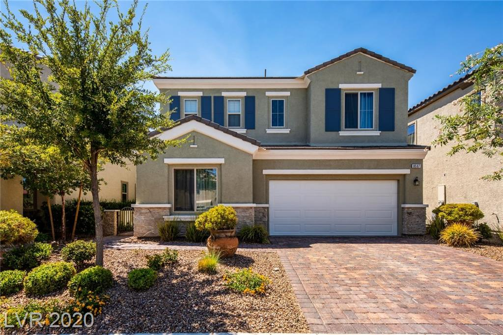 Turnkey former model home filled with over $100,000 in upgrades and appointments! Highly upgraded Safford model represents one of Vistaview's finest homes. Charming courtyard along with professionally designed landscape welcomes you. Two master suites, one up and one down, plus loft and den offer convenience. Highlights include hardwood flooring, shutters, two-tone interior paint scheme, upgraded open stair rail, granite kitchen countertops with tile backsplash, stainless steel kitchen appliances, apron sink, extended kitchen island, custom built-in cabinets in loft, closet organizer in master bedroom, freestanding tub in spa-inspired master bath, upgraded vanity and tile shower surround in master bath, thermostat with remote access, soft water loop, tankless water heater, surround sound pre-wire, alarm system pre-wire, paver driveway and walkway, rear covered patio, covered deck at second floor master bedroom. Ideally located in Southwest Las Vegas near Technology Park, and IKEA.