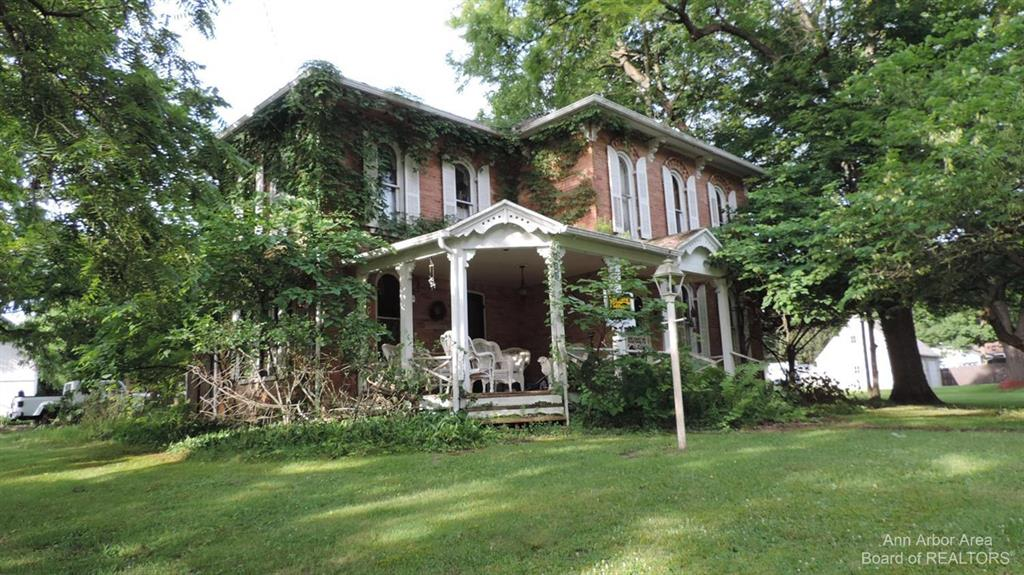 Historic home on 6 acres in the village of Manchester next to Carr park. Enjoy all the summer activities Manchester has to offer. Property has rolling hills along with many walnut trees. Home has been vacant for many years and will need extensive updates. enter a own risk. bring flashlights. Home has no power or water. this is a cash only sale.