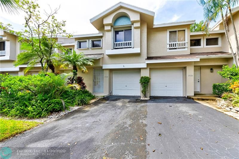 BRING YOUR FHA BUYERS! Well maintained 2/2.5 townhouse w/1 car garage in the gated community of Discovery Pointe. This townhome features: 2006 Roof, 2016 A/C, 2012 water heater, accordion shutters, first floor tile, 2nd floor laminate, real wood on stairs with upgraded railing, 2 master suites with walk in closets, washer & dryer and small patio. Low HOA fee includes building exterior, roof, insurance, lawn, gate, clubhouse, pool/spa, tennis/racquetball courts, gym and tot lot. Pet friendly (1 pet under 40lbs). Close to shopping, dining and highway.
