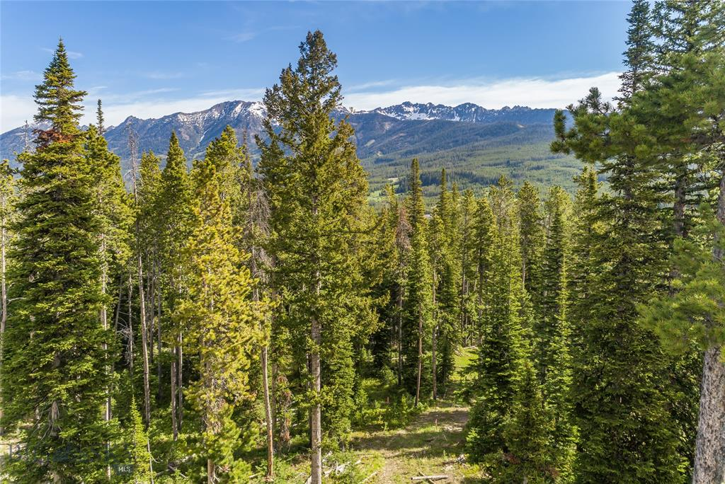 It's easy to see your family's mountain retreat come to life on this gently sloping 1.6-acre homesite. Complete with mature trees for privacy, yet still holds the highly coveted views of the Spanish Peaks Range and ski access most would envy...convenient ski-in/ski-out trail winds through the back of the property making this easy for all ski/board abilities. This property truly has it all and can be the ideal building site for your home in the mountains.