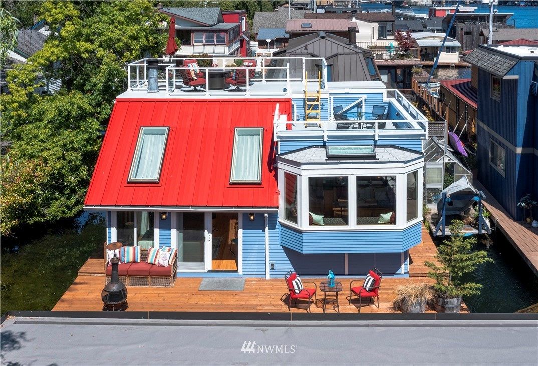At the end of this quiet dead end street is a very special floating home. Whether you're searching for your first home, looking to downsize, or just want an exciting lifestyle and change of pace, come see how your next adventure could mean owning a piece of Seattle's iconic floating home community. Beautifully updated throughout this 2 BR 1.75 BA has so much space! Vaulted ceilings, wood burning fireplace, wood-wrapped windows, beautiful kitchen open to dining space.  Built-in murphy bed in main floor BR makes it a great office!  Large BR on upper level & beautifully finished BA w/WIC. 2 roof-top decks to enjoy entertaining on. One parking space dedicated to this home and lots of deck space for your kayaks and SUP. No Home Owners Dues!