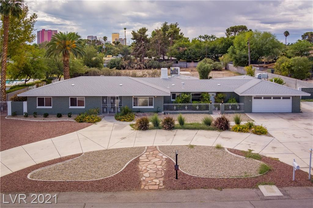 Fully Remodeled Vintage Single-Story, Ranch-Style Home Located Within the Desirable Historic McNeil Neighborhood, Near Downtown Las Vegas.  Home Sits on Almost a Full Acre Lot. Designed for Entertaining, The Front Doors Lead to the Open and Airy Style Living Room with Rare Wood-Burning Fireplace.  The Spacious Chef's Kitchen Offers Beautiful Custom Cabinets Accentuated with Open Shelving, Large Waterfall Island, New Stainless Steel Appliances, and Quartz Countertops with Large Walk-In Pantry. Primary Suite offers a Custom Bathroom with a Large Glass Shower, Free-Standing Tub, and a Double Floating Vanity. Other Features Include Three More Bedrooms Four Total Baths Right Under 3,000 Sq.Ft. Opulent Finishes Throughout, Formal Dining Room, and Large Glass Doors That Allow for Views of the Expansive Backyard that can be Turned Into an Entertainers Dream Backyard Large Enough for Anything you can Imagine.