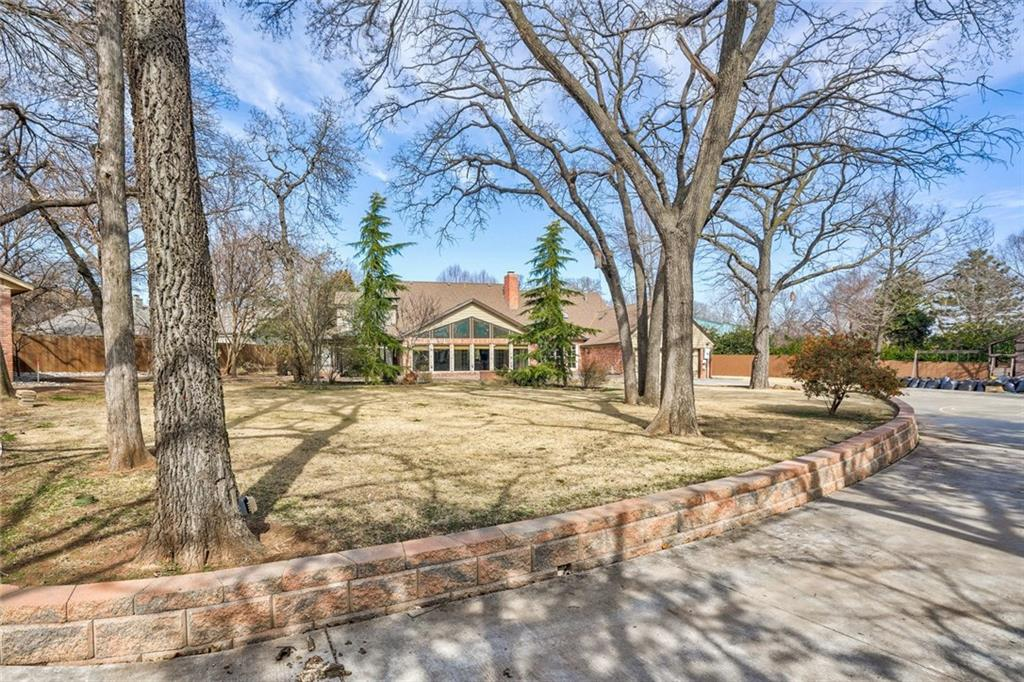 Wooded .83 acre property with heated & cooled 25 x 30 shop w/rear entry private electric gate in the heart of town! Convenient to downtown Edmond, UCO, restaurants, shopping, & easy access to major highways and turnpike. Enjoy the fruits of this owner's labor! Close to $200,000 in home improvements since 2013 (not enough room to list-provided upon request). Versatile floor plan w/4 beds + 2 studys, oversized family room w/French doors to huge Florida room, kitchen with 2 way FP and sitting area, formal dining, & upper level game room with play loft and extended bonus rooms that could be craft/exercise or additional play space – many uses to fit your lifestyle. 50 year Grand Manor Roof (2010), copper guttering, extensive landscaping and back drive w/basketball court, & shop w/H&A, woodworking vac system, dust filtration, and 110/220 electric w/separate sub panel from house – welding capabilities. HOA includes pool, clubhouse, park, tennis & basketball courts $350 per year.