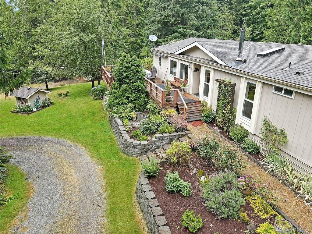 A long circular driveway leads you to this special oasis. Drive up to this secluded & private, beautiful territorial view 3 bedroom, 2 bath home on 7.7 acres.  Sit out on your covered back deck & listen to the babbling stream or sit on the huge front deck w/awning & bask in the sun.  Newer roof. New mstr flooring vanity & sinks. New int paint. Vaulted ceilings throughout.  Barn, out buildings, fire pit area, garden space, green house, fruit trees. Ample room for your hobbies/interests/toys & RV.
