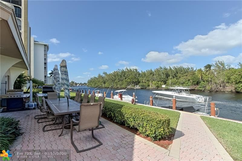 GREAT OPPORTUNITY in Hillsboro Landings II!  Magnificent 2 Bedroom 2 Bath Condo With Great Views, and Hurricane Impact Windows! This is an all ages building. Unit is Spectacular With Panoramic Views Of Historic Deerfield Island !Absolutely Stunning! This Two-Bedroom Features Over 1,230 Square Feet , 2 Separate Bedrooms With Separate Bathrooms And Large Balcony With Sliders In Master Bedroom. Both Bedrooms Have Updated In Suite Baths So Could Be Used As 2 Masters. Spacious Open Floor Plan W/ Living Room /Dinning Room Combo. Upgraded, Plenty Of Parking. Great Location Surrounded By Water, Capone Island, Sullivan Park, Restaurants & Shops At The Cove , Publix. Only 2 Blocks To Beach Just Over Bridge . Complex Ammenities Include Heated Pool, Clubhouse, Fitness Room, Sauna, Dock Space For Rent.