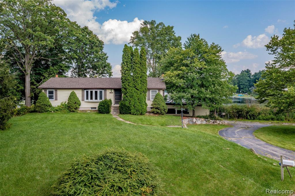 Amazing opportunity to own lakefront property! Nestled on 1.39 rolling acres of land, in the beautiful village of Ortonville, this multi-level home is just loaded with potential! Features of this unique home include a sunny walkout basement, 2 full-size kitchens, and a spacious living area with cozy wood burning fireplace. The partially wooded landscape offers up a private space to kick back and enjoy a quiet evening, or even catch a morning sunrise over the serene (no wake) Seymour Lake. Additional features of the home include a newer roof (2017), boiler, and windows (2000/2002 w/ 35 yr transferable warranty), Basement bay window and sliding glass door replaced in 2017 w/transferable warranty. All major appliances also included. This lovely waterfront property is ready and waiting for your finishing touches. Call for your private showing today!