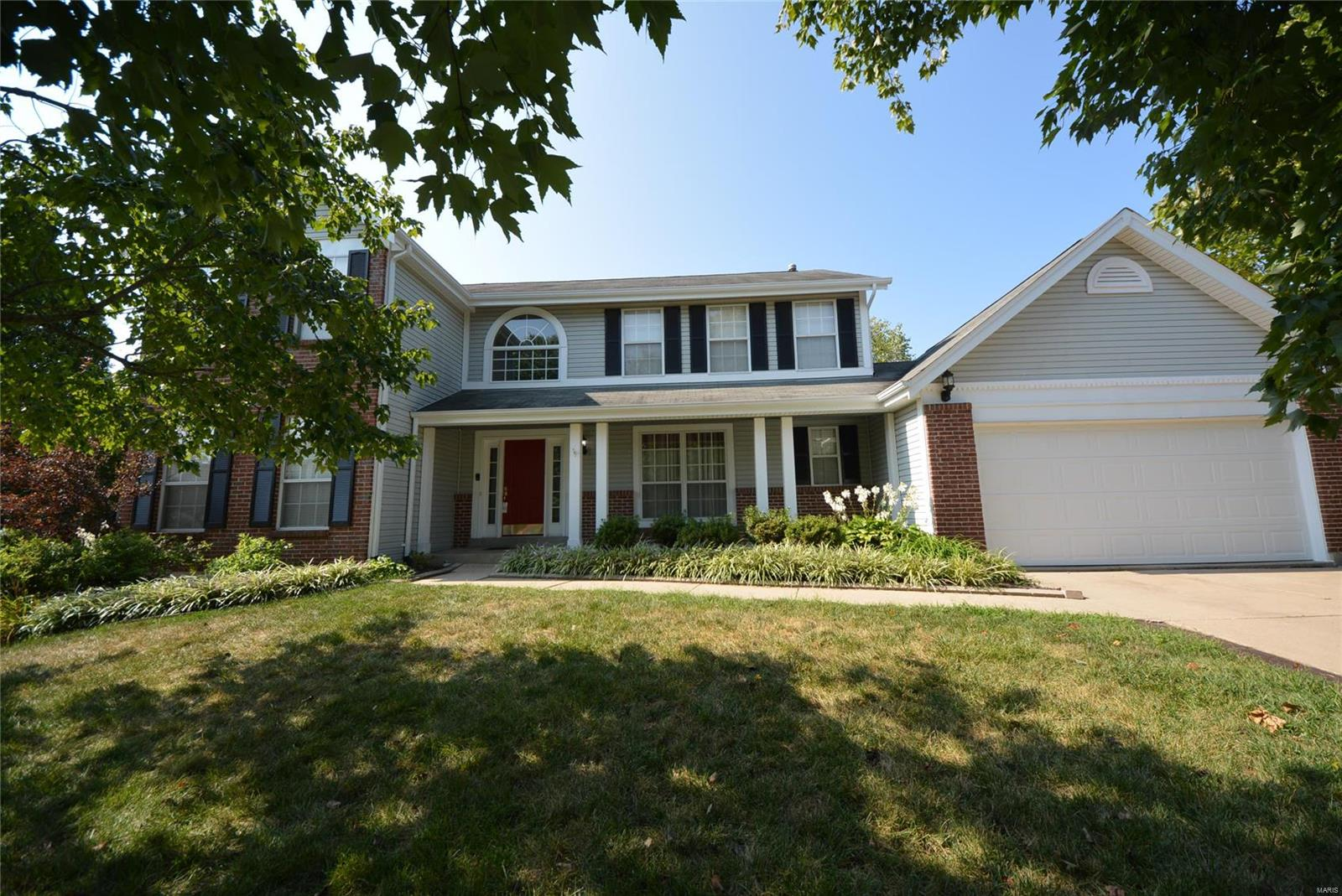 Beautiful, MOVE-IN-READY 4BR, 4BTH 2sty w/3880+SF of living space! Nestled in the heart of O'Fallon this home is loaded with curb appeal with vinyl front w/brick accents, covered porch, lush landscaping & 2 car garage. Welcoming entry foyer leads to the living rm & elegant dining rm. The spacious family rm features a gas fireplace & LG bay window. The LG kitchen w/hardwood floors offers a center island, tile backsplash, stylish black appliances (all included), work station, pantry & bkft rm w/bay window & slider to the refinished deck looking out to the lvl fenced yard perfect for outdoor enjoyment. Powder rm & laundry complete the main. The upper lvl offers the master suite w/vaulted ceilings, walk in closet & private full bth w/dbl vanity, soaking tub & sept shower. 3 add'l BR & full bth complete the upper lvl. The finished LL provides a LG family rm w/built-ins, den, sitting rm, add'l possibly sleeping rm & half bth. Great location w/easy access to major highways & great schools.